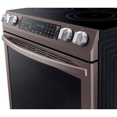 Angled control panel view of the 5.8 cubic foot Tuscan Samsung electric range- NE58R9431St