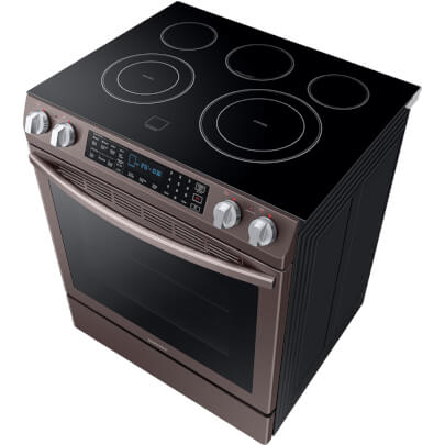 Angled overhead cook top view of the 5.8 cubic foot Tuscan Samsung electric range- NE58R9431St