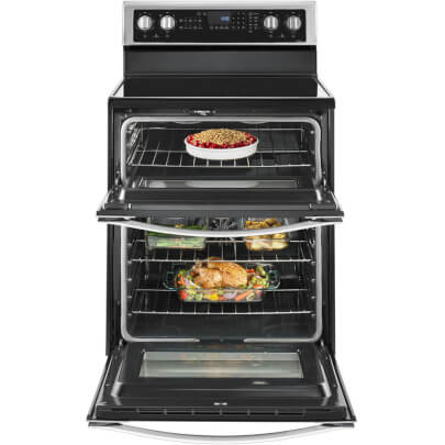 Front view with open oven door of the 6.7 cubic foot stainless steel Whirlpool double oven range- WGE745C0FS