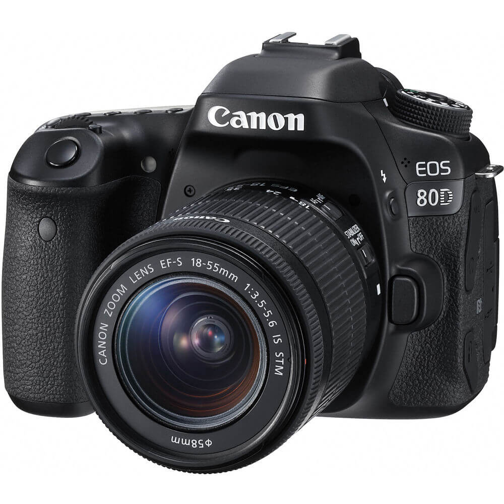 Angled front view of the Canon EOS 80D DSLR with 18 - 55 millimeter lens- EOD80DKIT