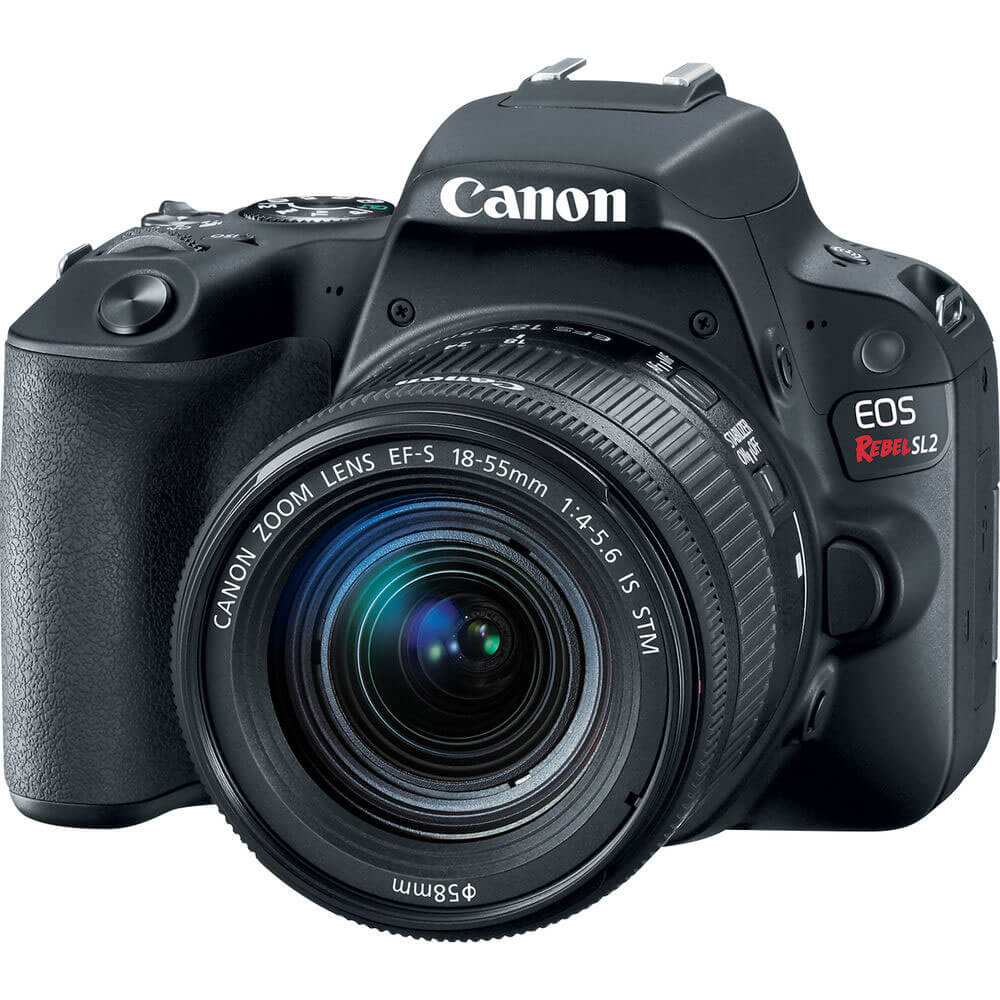 Angled front view of the Canon EOS rebel SL2 DSLR camera with a 18-55 millimeter lens- EOSREBEL2SL2