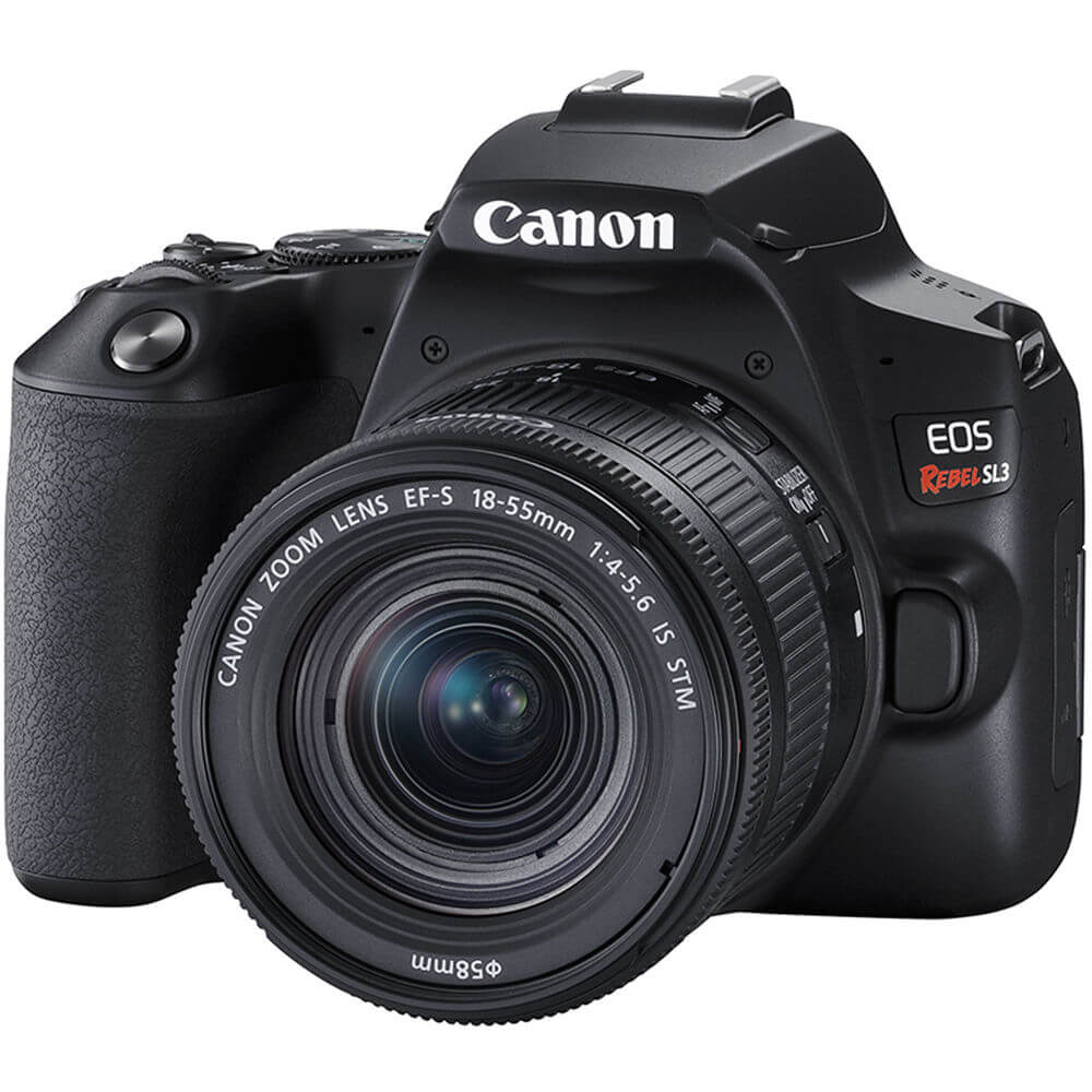 Angled front view of the Canon EOS Rebel SL3 DSLR camera with a 18-55 millimeter lens- EOSREBELSL3