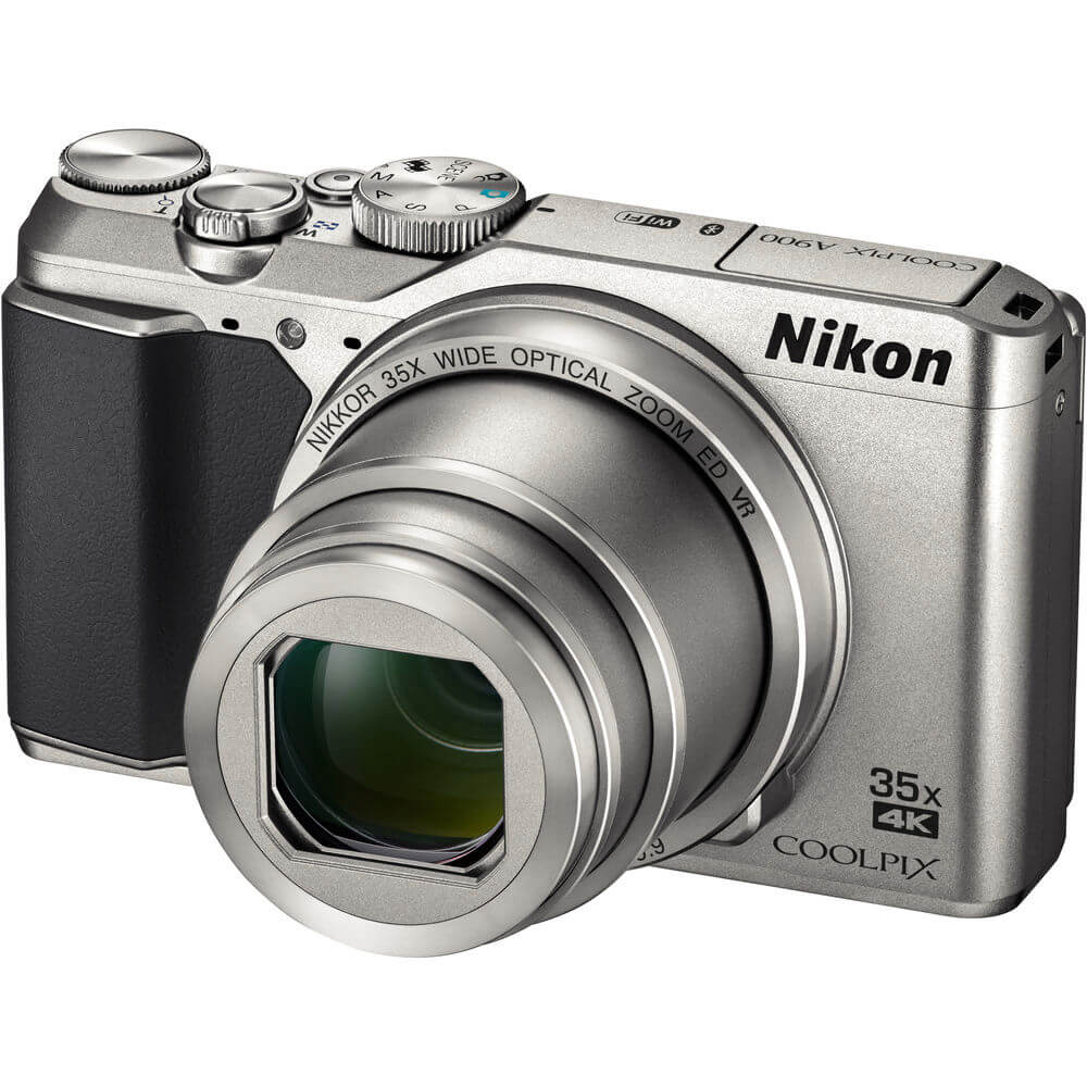 Angled front view of the silver Nikon Coolpix 20 mega-pixel digital camera- A900