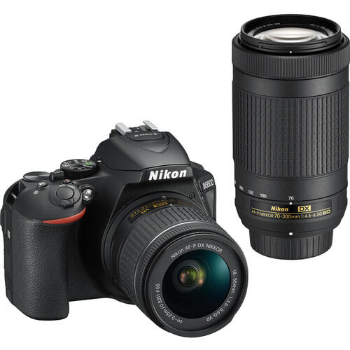 Angled front view of the Nikon D5600 DSLR camera with 2 lenses- D5600BUND